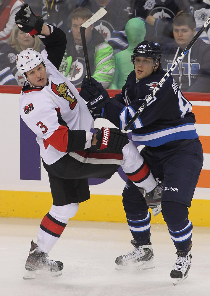 Description of . WINNIPEG, CANADA - JANUARY 19:  Marc Methot #3 of the Ottawa Senators collides with Nik Antropov #80 of the Winnipeg Jets during third-period action on January 19, 2013 at the MTS Centre in Winnipeg, Manitoba, Canada.  (Photo by Marianne Helm/Getty Images)