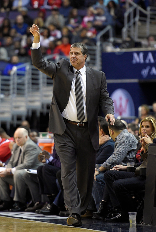 . Washington Wizards head coach Randy Wittman gestures during the second half of an NBA basketball game against the Denver Nuggets, Friday, Dec. 5, 2014, in Washington. (AP Photo/Nick Wass)