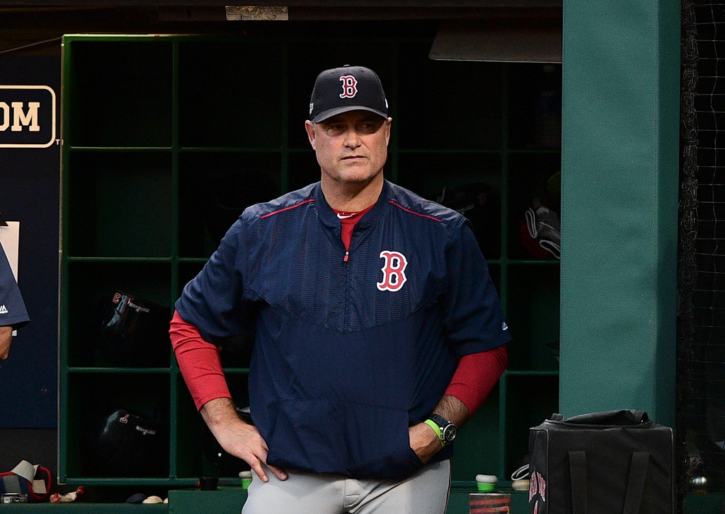 . Boston Red Sox manager John Farrell watches from the dugout during the sixth inning against the Cleveland Indians in Game 2 of a baseball American League Division Series, Friday, Oct. 7, 2016, in Cleveland. (AP Photo/David Dermer)