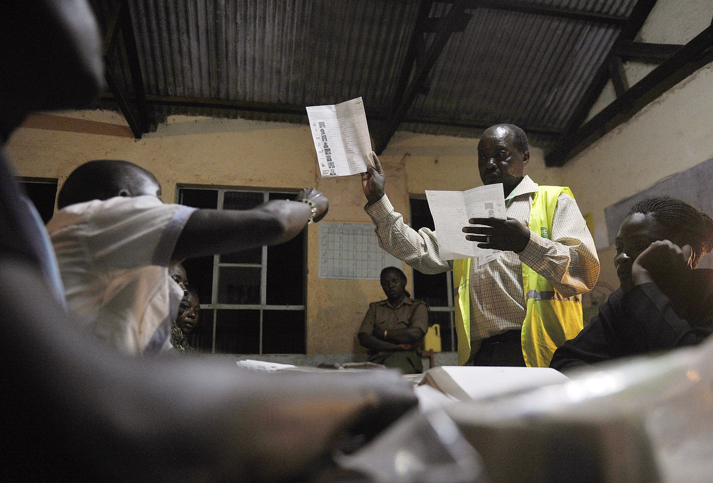 . Poll officials count ballots at a polling centre following Kenya\'s national elections on March 4, 2013 in the country\'s western province in Kakamega. Long lines of Kenyans queued from way before dawn to vote today in the first election since the violence-wracked polls five years ago, with a deadly police ambush hours before polling started marring the key ballot. The tense elections are seen as a crucial test for Kenya, with leaders vowing to avoid a repeat of the bloody 2007-8 post-poll violence in which over 1,100 people were killed and observers repeatedly warning of the risk of renewed conflict.       TONY KARUMBA/AFP/Getty Images