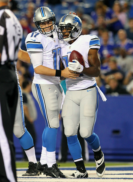 . Detroit Lions\' Jeremy Ross, right, and quarterback Kellen Moore celebrate after they connected for a touchdown pass against the Buffalo Bills during the first half of a preseason NFL football game, Thursday, Aug. 28, 2014, in Orchard Park, N.Y. (AP Photo/Bill Wippert)