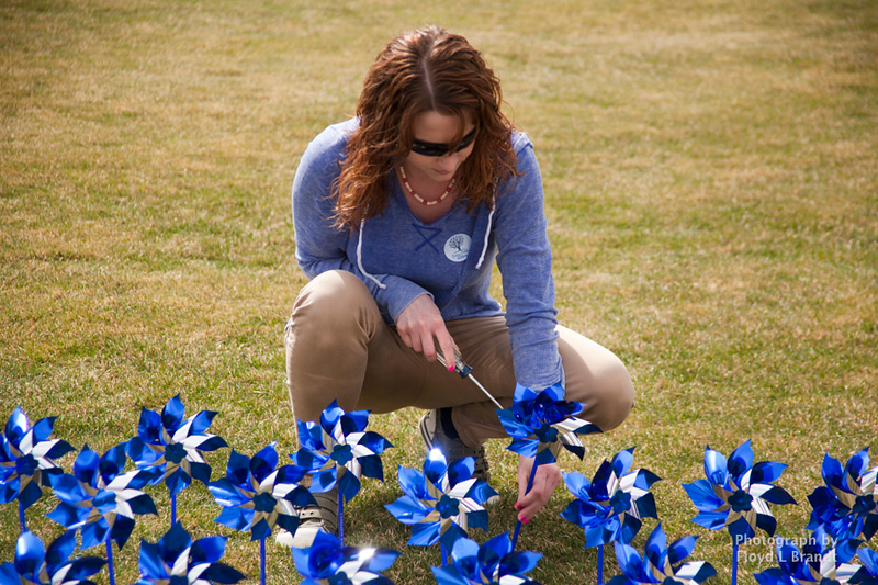 Havre Daily News/Floyd BrandtCASA member Hasanna Hutchins met in Town Square to plant pinwheels Thursday. Each pinwheel represents a child that CASA has intervended for. There are 211 pinwheels planted in the square. Executive Director Mark Douglas said that he was glad that the number not any higher.
