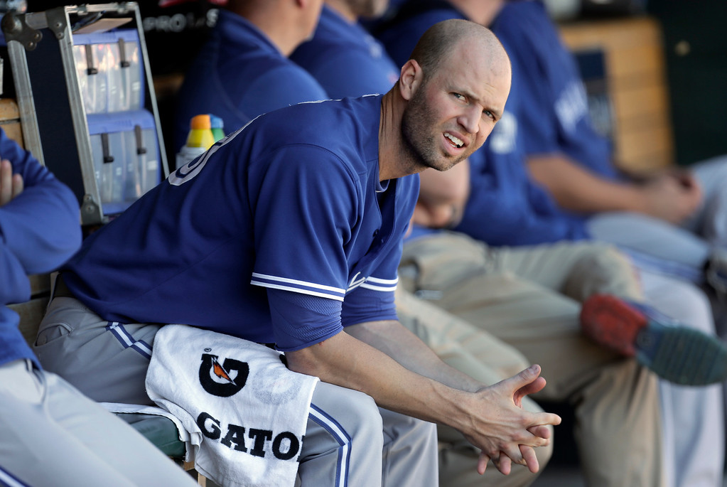 . Toronto Blue Jays pitcher J.A. Happ sits on the bench against the Detroit Tigers in the eighth inning of a baseball game in Detroit, Thursday, June 5, 2014. (AP Photo/Paul Sancya)