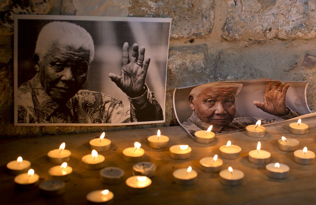 . Candles are placed in front of the images of the late South African leader Nelson Mandela who died two days ago, during a vigil by Palestinians and members of the African community in Old City of Jerusalem on President on December 7, 2013. Palestinian leaders drew on the legacy of Nelson Mandela, a high-profile supporter of their cause, likening his fight against apartheid to their own struggle to end Israeli occupation. AFP PHOTO / AHMAD GHARABLI/AFP/Getty Images