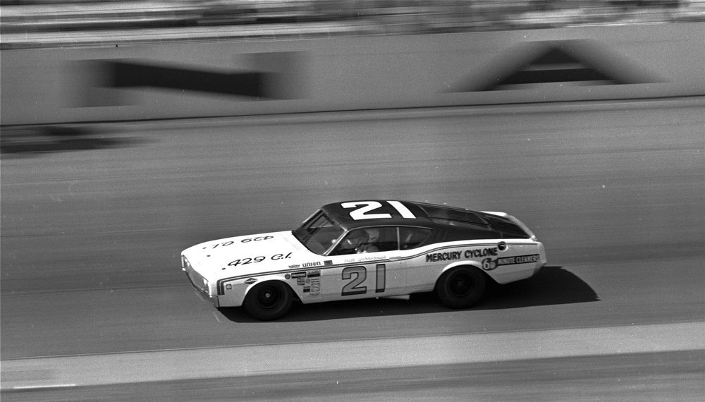 Description of . Driving a 69 Mercury, Cale Yarborough, Timmonsville, S.C., set a new track record February 8, 1970 at the Daytona International Speedway with a one-lap-speed of 194.015 mph during qualifying for the Daytona 500.  Yarborough captured the pole position with the record lap.  (AP Photo/CS)