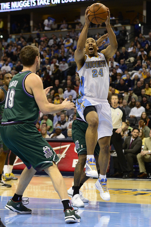 . DENVER, CO - FEBRUARY 5: Andre Miller Denver Nuggets (24) goes up for a shot against the Milwaukee Bucks during the second half of action. The Denver Nuggets defeat the Milwaukee Bucks 112-104 in NBA action at the Pepsi Center. (Photo By AAron Ontiveroz/The Denver Post)