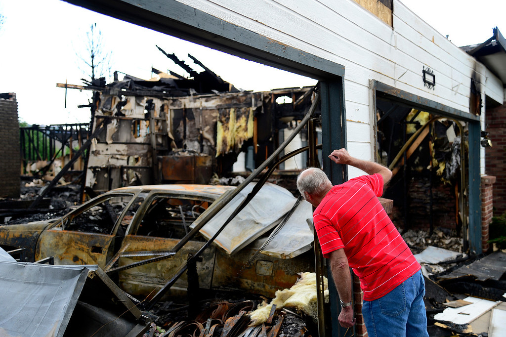 . Harold Luther, 80, looks at the remains of his burned home in the Mountain Shadows subdivision in Colorado Springs Sunday, July 1, 2012. Luther\'s home, on the corner of Flying W Ranch Rd. and Manning Way was the only home on the block to burn but is one of more than 350 homes that burned in the Waldo Canyon Fire. Mahala Gaylord, The Denver Post