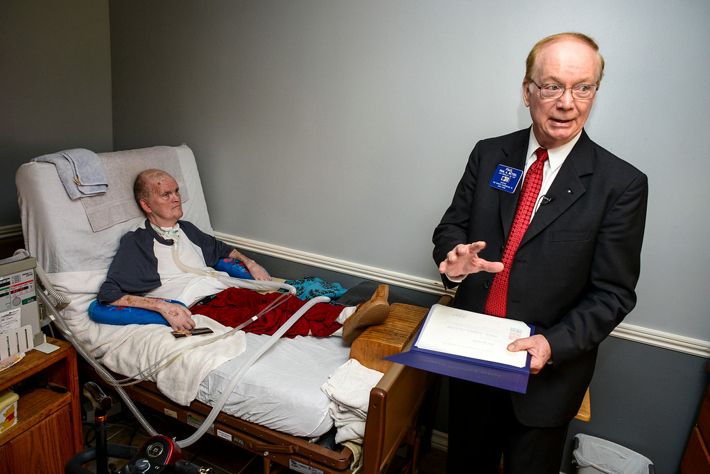 . Paul Netzel, Trustee of Rotary Foundation, right, presents  Joe Garcia of Chatsworth, left, with the Paul Harris Fellow Award Tuesday, July 15, 2014.  Garcia, 73, has been paralyzed from the neck down from polio since 1960.    ( Photo by David Crane/Los Angeles Daily News )