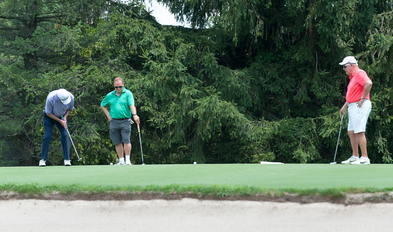 07/16/18  Wesley Bunnell | Staff  The 2018 Mayor's Cup Golf Outing took place on Monday morning at Chippanee Country Club benefitting the Boys and Girls Club of Bristol.    Barry Smith, middle, and Greg Fradette, R, watch as Gary Soucy putts on the 9th hole.