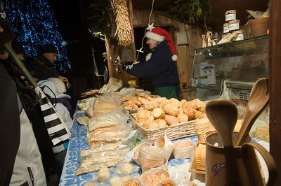 People shopping at Christmas Market at night, Main Square, Cracow, Poland