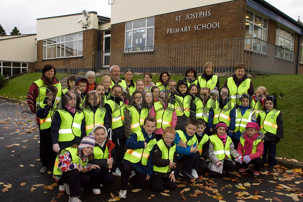 Pictured are pupils from St Josephs PS Bessbrook who took part in a Road Safety Walk. 10W45N4