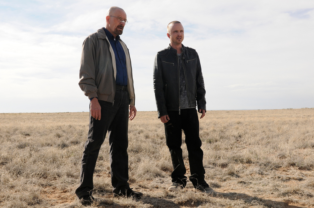 ". This image released by AMC shows Bryan Cranston as Walter White, left, and Aaron Paul as Jesse Pinkman in a scene from ""Breaking Bad.\""  he program was nominated for an Emmy Award for outstanding drama series on, Thursday July 18, 2013.  Paul was nominated for best supporting actor in a drama series and Cranston was nominated for best actor in a drama series. The Academy of Television Arts & Sciences\' Emmy ceremony will be hosted by Neil Patrick Harris. It will air Sept. 22 on CBS.  (AP Photo/AMC, Ursula Coyote)"
