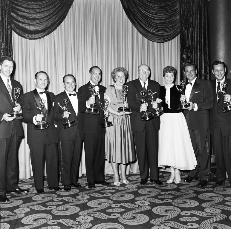". HOLLYWOOD, CA - FEBRUARY 11, 1954: Winner for Best Comedy Show for ""I Love Lucy,\"" (fourth from left) CBS Program Chief Harry Ackerman, actress Vivian Vance with her award for  Best Supporting Actress for \""I Love Lucy,\"" Dr. Frank Baxter with two LA Area Emmy Awards for �Shakespeare on TV,� actors Lucille Ball and Desi Arnaz with their awards for �I Love Lucy,� and Mike Stokey with his award for the L.A. Area Show �Juke Box Jury,\"" at the Hollywood Palladium on February 21, 1954 in Hollywood, California. (Photo by TVA/PictureGroup/Invision for the Academy of Television Arts & Sciences/AP Images)"