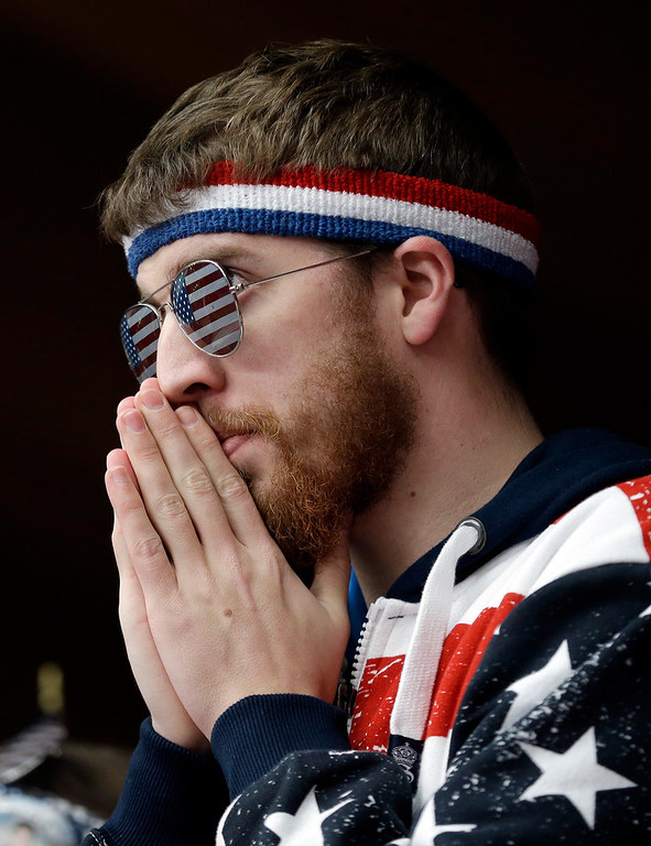 . A fan watches as Kate Hansen of the United States competes during the women\'s singles luge competition at the 2014 Winter Olympics, Tuesday, Feb. 11, 2014, in Krasnaya Polyana, Russia. (AP Photo/Natacha Pisarenko)