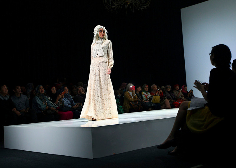 . In this Saturday, May 31, 2013 photo, a model showcases a creation by Indonesian designer Irna Mutiara during the Islamic Fashion Fair in Jakarta, Indonesia. The event is part of the Indonesian government\'s effort to turn the most populous Muslim country into the world\'s Islamic fashion capital by 2020. (AP Photo/Dita Alangkara)