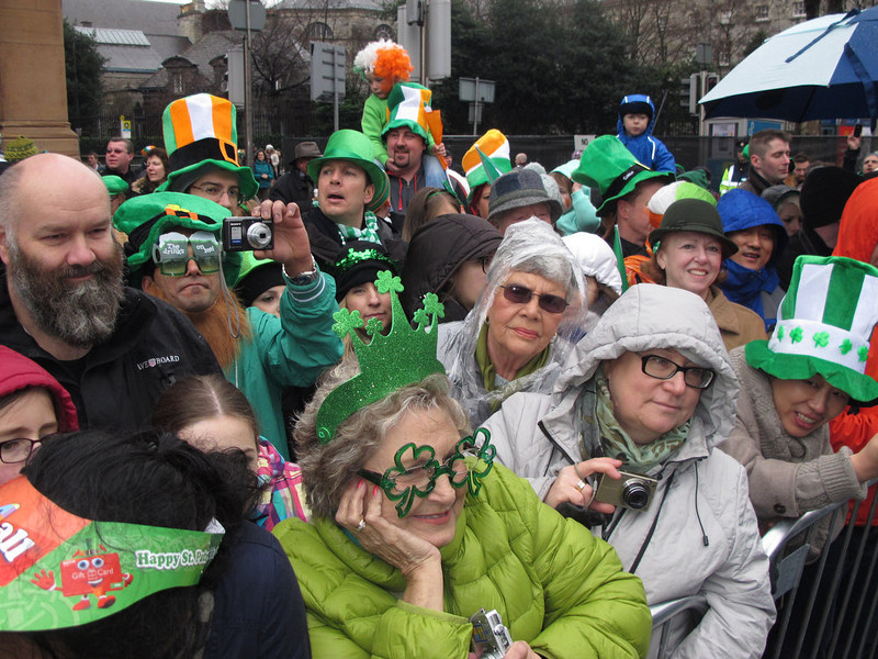 . Spectators watch the St. Patrick\'s Day parade in Dublin, Sunday, March 17, 2013. Never mind the fickle Irish weather - a chilly, damp Dublin celebrated St. Patrick\'s Day with artistic flair Sunday as the focal point for a weekend of Irish celebrations worldwide. (AP Photo/Shawn Pogatchnik)