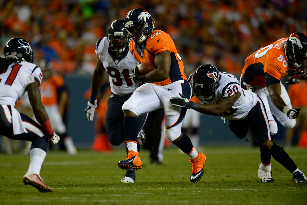 . DENVER, CO - AUGUST 23:  C.J. Anderson (22) of the Denver Broncos carries the ball against the Houston Texans during a preseason football game at Sports Authority Field at Mile High on Saturday, August 23, 2014 in Denver, Colorado.  (Photo by Kent Nishimura/The Denver Post)