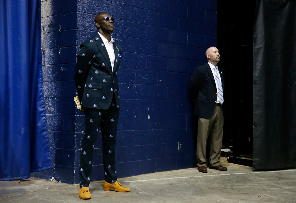 . Former wide receiver Terrell Owens, left, waits to go onto the stage Saturday, Aug. 4, 2018, in Chattanooga, Tenn. Instead of giving his Pro Football Hall of Fame speech in Canton, Ohio, Owens celebrated his induction at the University of Tennessee at Chattanooga, where he played football and basketball and ran track. (AP Photo/Mark Humphrey)