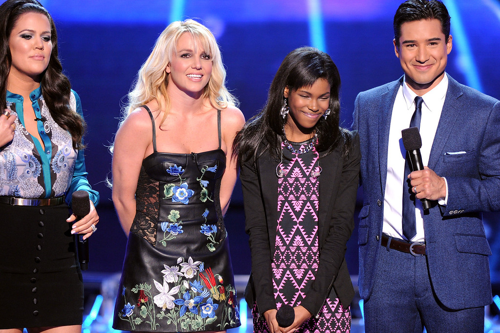 """. HOLLYWOOD, CA - DECEMBER 6: (L-R) Host Khloe Kardashian Odom, judge Britney Spears, eliminated contestant Diamond White and host Mario Lopez onstage at FOX\'s \""""The X Factor\"""" Season 2 Top 6 to 4 Live Elimination Show on December 6, 2012 in Hollywood, California. (Photo by Frank Micelotta/PictureGroup) via AP IMAGES"""