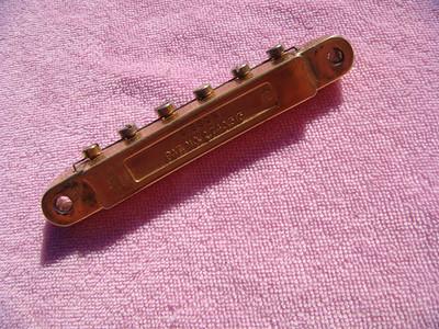 1965 Gibson gold patent # bridge 1/2 nylon saddles