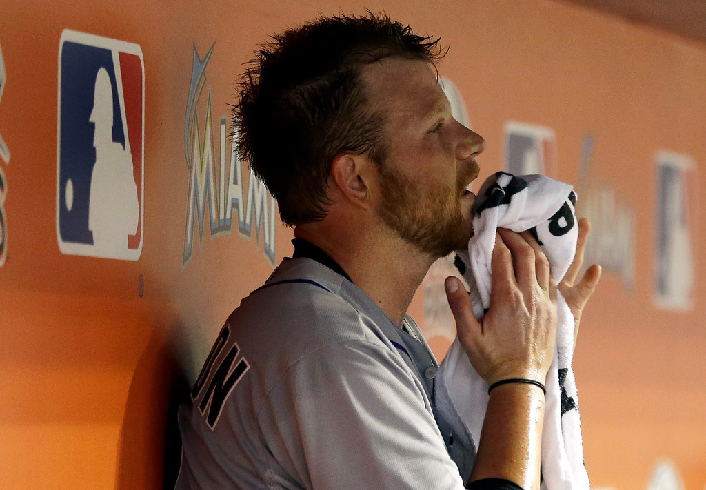 . Colorado Rockies starting pitcher Brett Anderson sits in the dugout in the seventh inning of a baseball game against the Miami Marlins, Tuesday, April 1, 2014, in Miami. The Marlins defeated the Rockies 4-3. (AP Photo/Lynne Sladky)