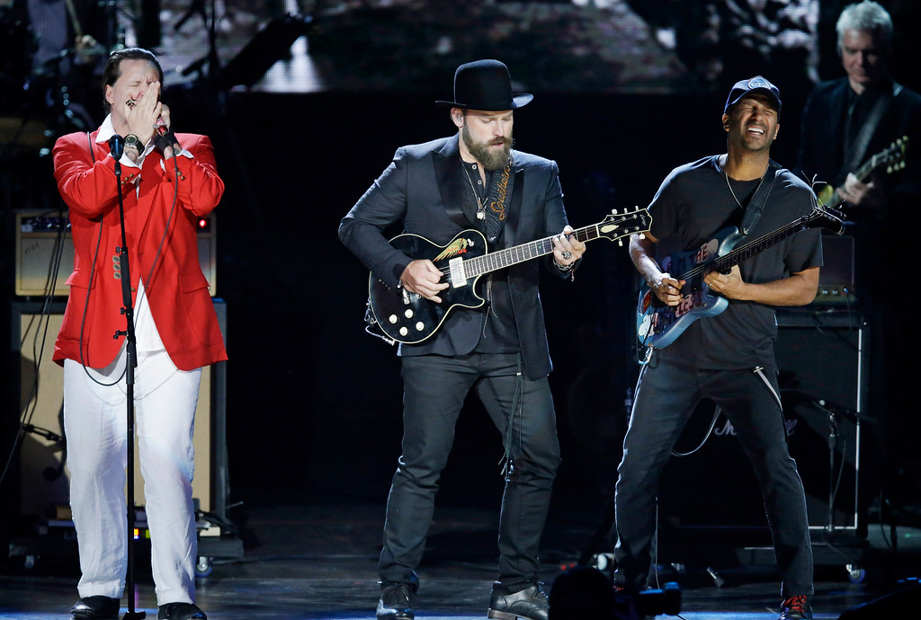 . Jason Ricci, left to right, Zak Brown and Tom Morello perform at the Rock and Roll Hall of Fame Induction Ceremony Saturday, April 18, 2015, in Cleveland. (AP Photo/Mark Duncan)