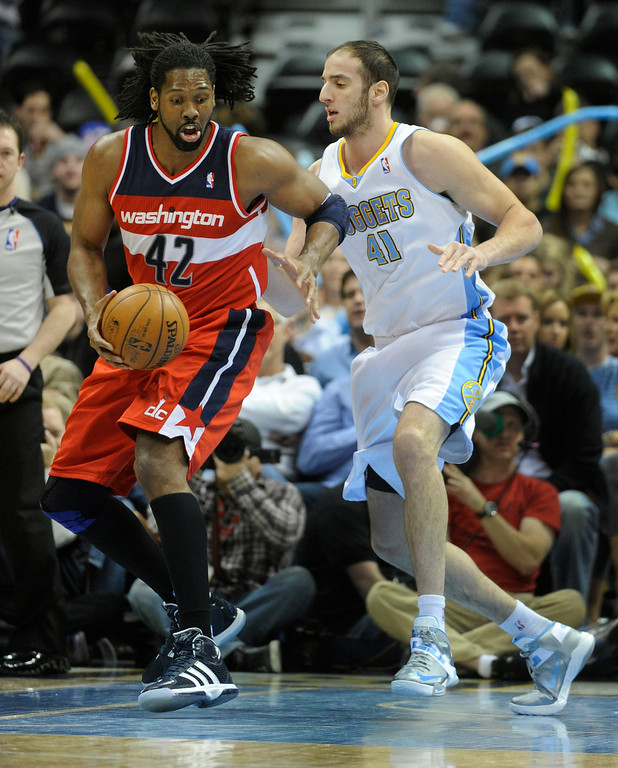 . DENVER, CO - JANUARY 18: Washington forward Nene worked against DEnver center Kosta Koufos in the first half. The Denver Nuggets hosted the Washington Wizard at the Pepsi Center Friday night, January 18, 2013. Karl Gehring/The Denver Post