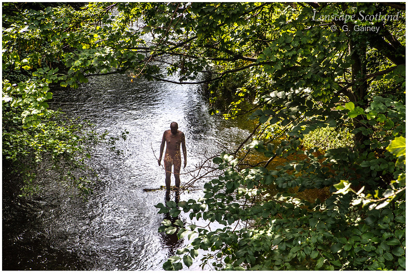 Anthony Gormley '6 Times' statue in Water of Leith at Stockbridge