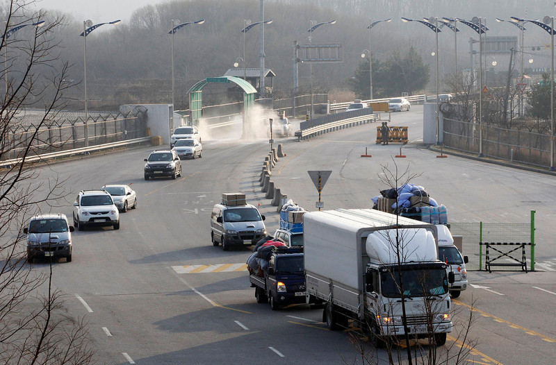 . South Korean vehicles return from the North Korean city of Kaesong at the customs, immigration and quarantine office in Paju, South Korea, near the border village of Panmunjom, Thursday, April 4, 2013. North Korea on Wednesday barred South Korean workers from entering a jointly run factory park just over the heavily armed border in the North, officials in Seoul said, a day after Pyongyang announced it would restart its long-shuttered plutonium reactor and increase production of nuclear weapons material. (AP Photo/Ahn Young-joon)