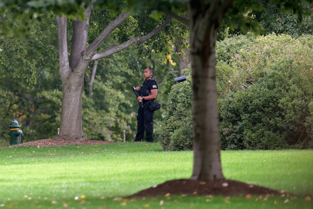 . A member of the U.S. Secret Service counter assult team patrols the grounds of the White House October 3, 2013 in Washington, DC. The executive mansion was put on lockdown after a report of shots fired at the U.S. Capitol.  (Photo by Chip Somodevilla/Getty Images)