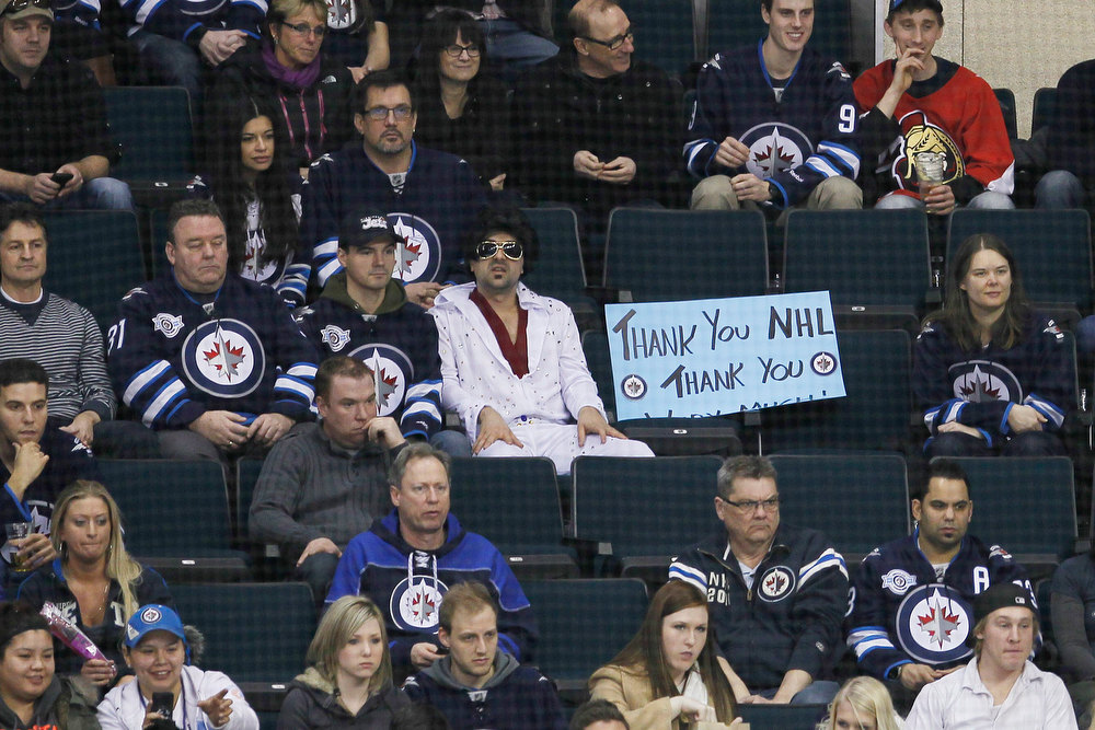 . Winnipeg Jets\' fans thank the NHL during first-period NHL hockey game action between the Jets and the Ottawa Senators in Winnipeg, Manitoba, Saturday, Jan. 19, 2013. (AP Photo/The Canadian Press, John Woods)