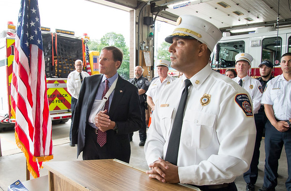 09/13/19 Wesley Bunnell | StaffrrThe New Britain Fire Department is receiving federal grant money to improve safety in the fire houses along with EMS workers receiving grant money to replace aging equipment in a press conference announced by Senator Richard Blumenthal and Mayor Erin Stewart. Fire Chief Raul Ortiz speaks during the conference stands at the podium next to Senator Blumenthal as they answer questions.