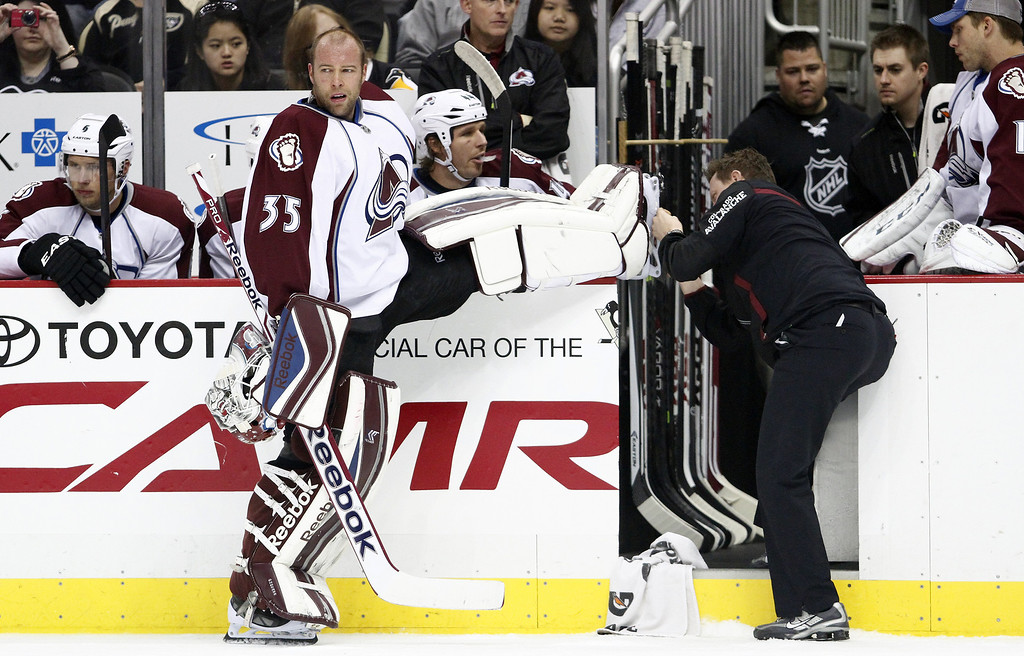 . Jean-Sebastien Giguere #35 of the Colorado Avalanche has his skate tended to against the Pittsburgh Penguins during the game at Consol Energy Center on October 21, 2013 in Pittsburgh, Pennsylvania.  (Photo by Justin K. Aller/Getty Images)