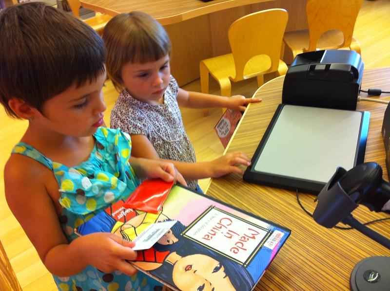 Guen checks out her first book!