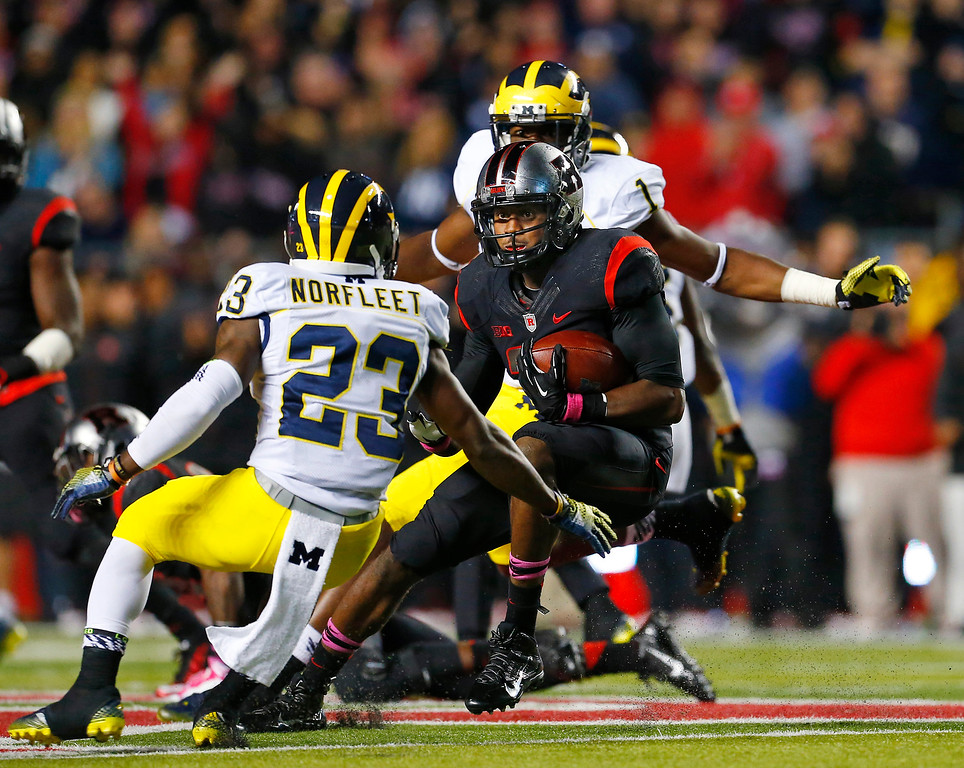 . Rutgers defensive back Davon Jacobs (29) looks to get past Michigan\'s Dennis Norfleet (23) after Jacobs intercepted a pass during the second half of an NCAA college football game Saturday, Oct. 4, 2014, in Piscataway, N.J. Rutgers defeated Michigan 26-24. (AP Photo/Rich Schultz)