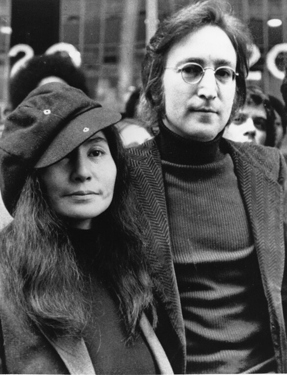 . In this file photo dated April 18, 1972, John Lennon, right, and Yoko Ono, left, are seen outside the U.S. Immigration offices in New York City, USA. Vatican media praised the Beatles\' musical legacy on Saturday, Nov. 22, 2008. John Lennon\'s boast that the British band was more popular than Jesus outraged many when he made it in 1966, Vatican newspaper L\'Osservatore Romano noted, but that the remark can be written off now as the bragging of a young man wrestling with unexpected success. (AP Photo, File)