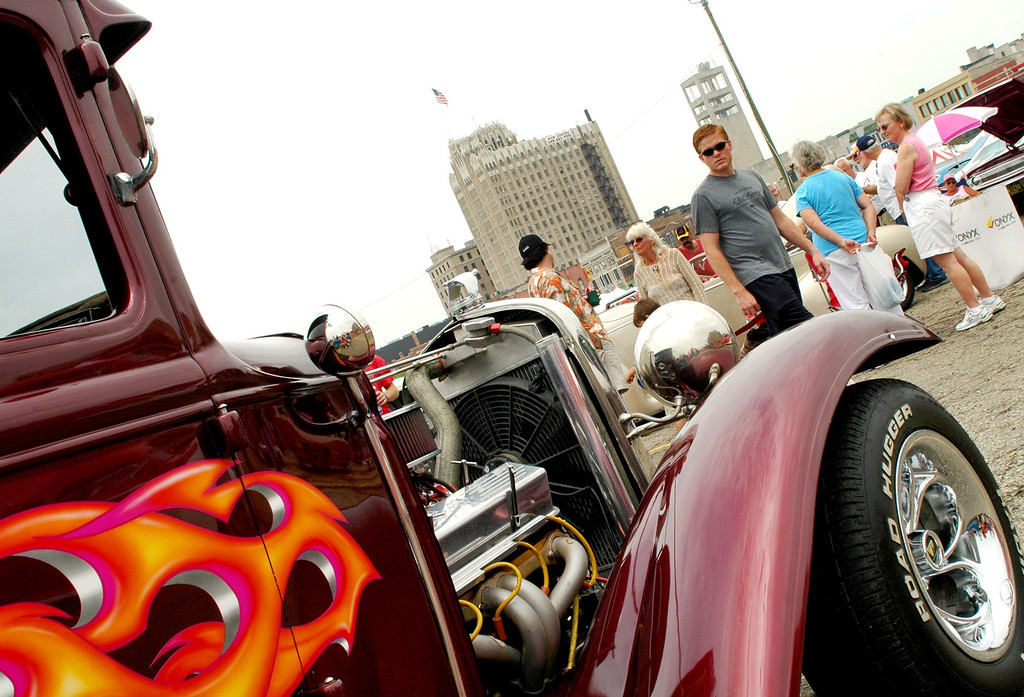 . Enthusiasts check out cars during the Woodward Dream Cruise, including this 1931 Ford Coupe parked in Pontiac Saturday.