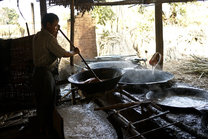 The final step is to cool the jaggery before it is spread out to cool in thin layers, near Nyaung Shwe, on Inle Lake, Burma (Myanmar).