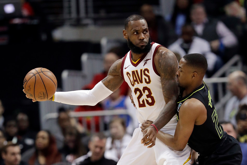 . Cleveland Cavaliers forward LeBron James (23) works against Atlanta Hawks guard Isaiah Taylor (22) during the first half of an NBA basketball game Friday, Feb. 9, 2018, in Atlanta. (AP Photo/John Bazemore)