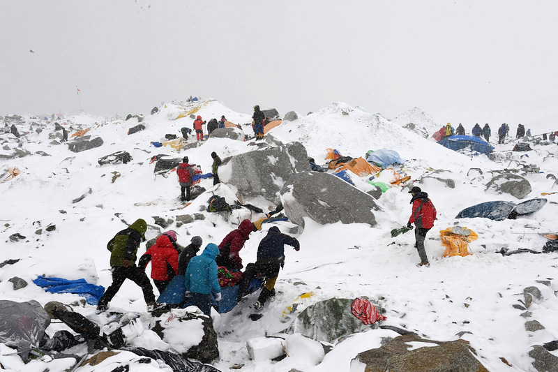 . Sherpas, climbers, porters and rescue teams help carry a person injured by an avalanche that flattened part of Everest Base Camp. Rescuers in Nepal are searching frantically for survivors of a huge quake, that killed nearly 2,000, digging through rubble in the devastated capital Kathmandu and airlifting victims of an avalanche at Everest base camp.  ROBERTO SCHMIDT/AFP/Getty Images