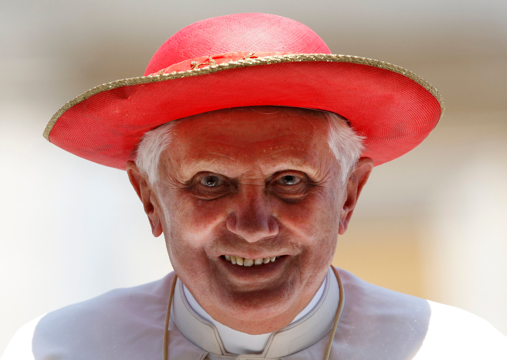 . Pope Benedict XVI wears a Saturno hat as he leaves at the end of his Wednesday general audience in Saint Peter\'s Square at the Vatican in this June 3, 2009 file photo. Pope Benedict said on February 11, 2013 he will resign on Feb 28 because he no longer has the strength to fulfill the duties of his office, becoming the first pontiff since the Middle Ages to take such a step. REUTERS/Giampiero Sposito/Files