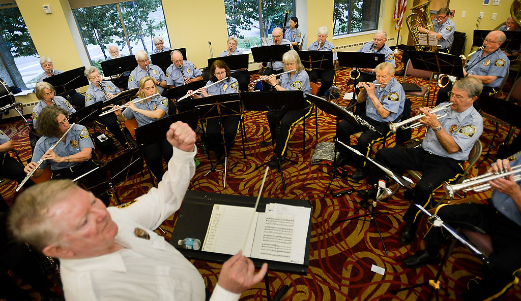 . Band director Bob Dynan of St. Paul leads members of the St. Paul Police Band in a concert at Shaller Family Sholom East Campus assisted living complex in St. Paul, Minn., on Tuesday, July 30, 2013. The band no longer features many active-duty officers but on it\'s 90th Anniversary it\'s still going strong in its mission to spread musical goodwill on behalf of the department. (Pioneer Press: Ben Garvin)