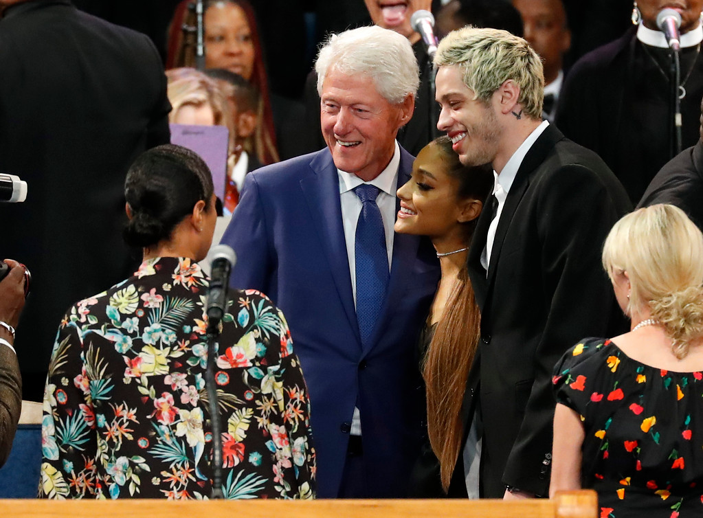 . Former President Bill Clinton poses for a photo with Ariana Grande, center, and Pete Davidson, right, during the funeral service for Aretha Franklin at Greater Grace Temple, Friday, Aug. 31, 2018, in Detroit. Franklin died Aug. 16, 2018 of pancreatic cancer at the age of 76. (AP Photo/Paul Sancya)
