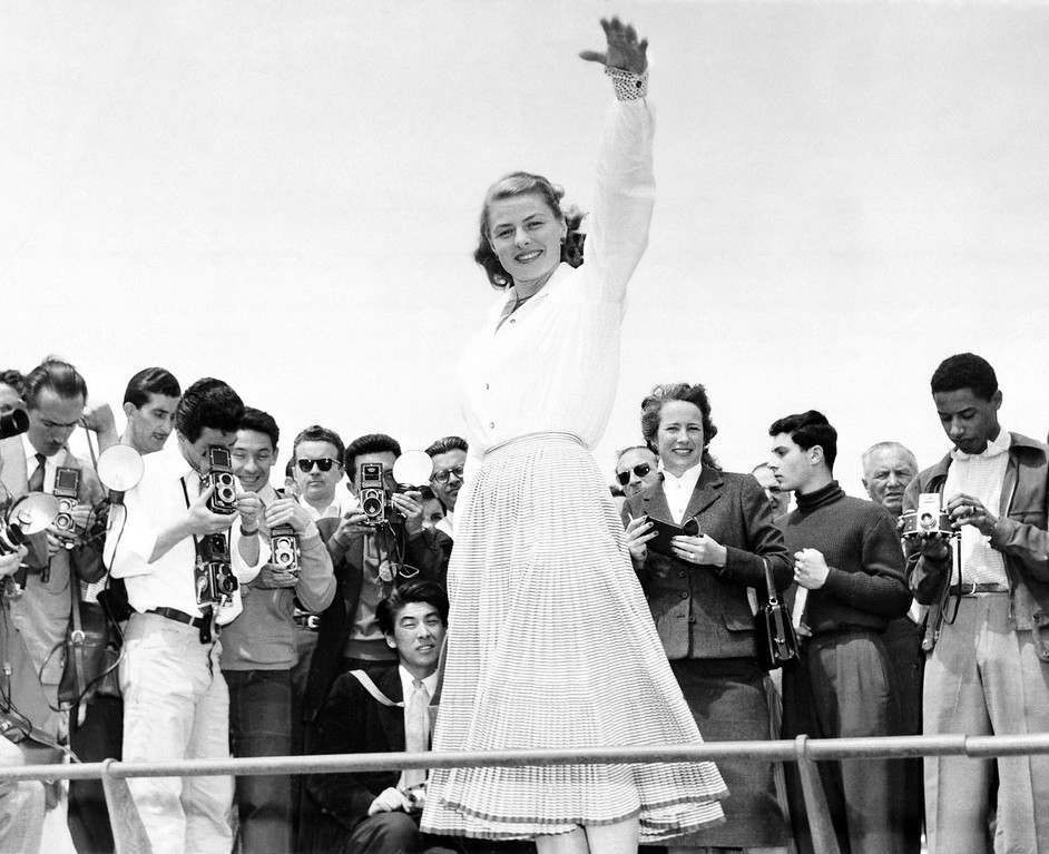 . Ingrid Bergman is snapped from all sides by a crowd of photographers at Cannes, May 16, 1956. She was one of the attractions at the film festival on the Riviera. (AP Photo)