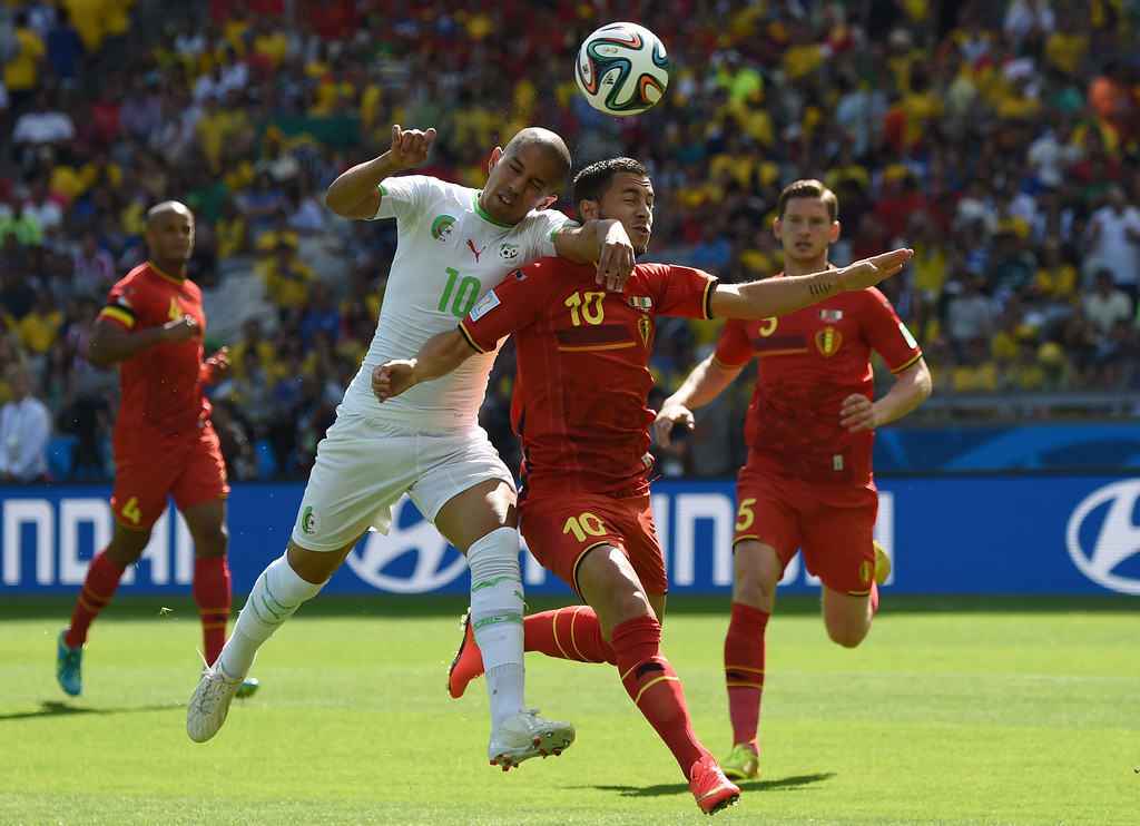 . Algeria\'s forward Sofiane Feghouli (C-L) and Belgium\'s forward Eden Hazard (C-R) vie for the ball during a Group H football match between Belgium and Algeria at the Mineirao Stadium in Belo Horizonte during the 2014 FIFA World Cup on June 17, 2014. CHRISTOPHE SIMON/AFP/Getty Images