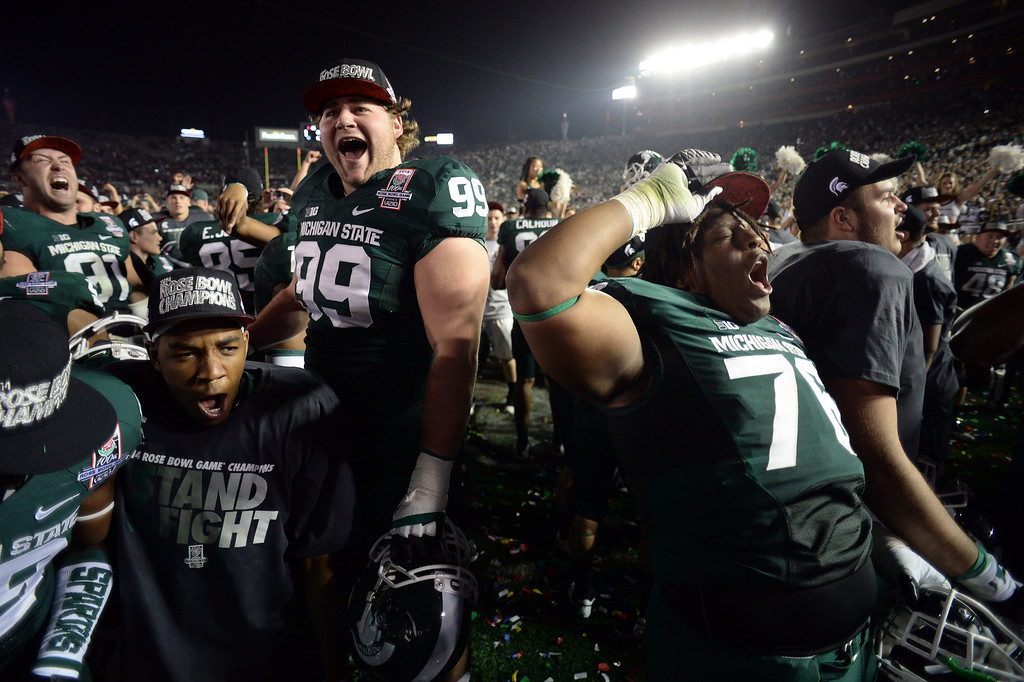 . Michigan State players celebrate during the 100th Rose Bowl game in Pasadena Wednesday, January 1, 2014. Michigan State defeated Stanford 24-20. (Photo by Hans Gutknecht/Los Angeles Daily News)