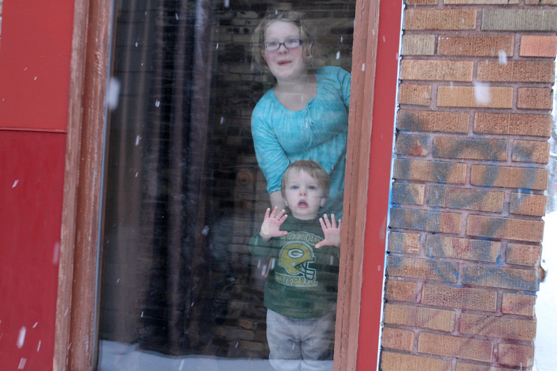 "Little Glenn, with his Mom, watches the snow come down as the rest of the world goes by.  Maybe life is simplier before we ""grow up"".  What will Glenn's world be like ?"