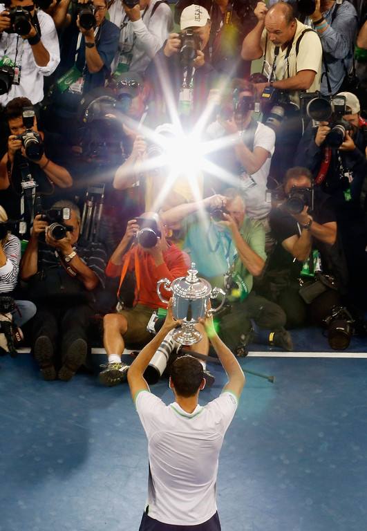 . The media photograph Marin Cilic of Croatia as he celebrates with the trophy after defeating  Kei Nishikori of Japan to win the men\'s singles final match on Day Fifteen of the 2014 US Open at the USTA Billie Jean King National Tennis Center on September 8, 2014 in the Flushing neighborhood of the Queens borough of New York City.  (Photo by Mike Stobe/Getty Images for USTA)