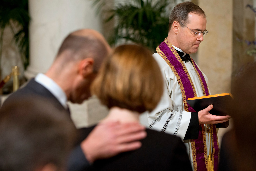 . Father Paul Scalia leads a prayer during a private ceremony for his father Justice Antonin Scalia during a private ceremony in the Great Hall of the Supreme Court in Washington, Friday, Feb. 19, 2016,where late Supreme Court Justice Antonin Scalia lies in repose. (AP Photo/Jacquelyn Martin, Pool)