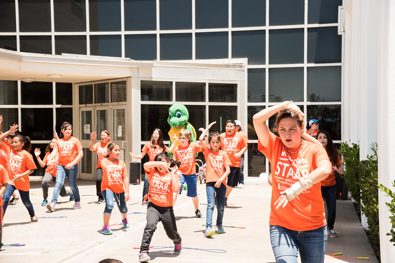 Kids dancing at the ECDC in their pep rally before the STSR test